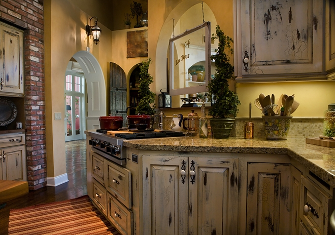 Country kitchen with antique distressed cabinetry